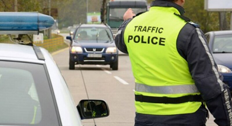 The traffic police stops cars with tinted windows image